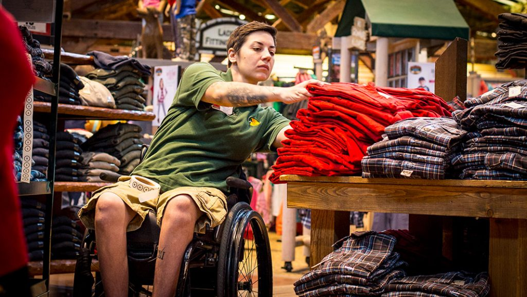 A person in a wheelchair working in a retail store.