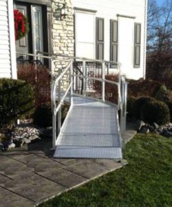an aluminum ramp leading into a home