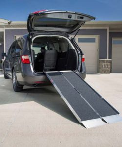 a portable ramp on the back of a vehicle