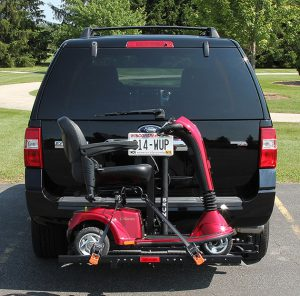 an exterior wheelchair lift holding a motorized scooter