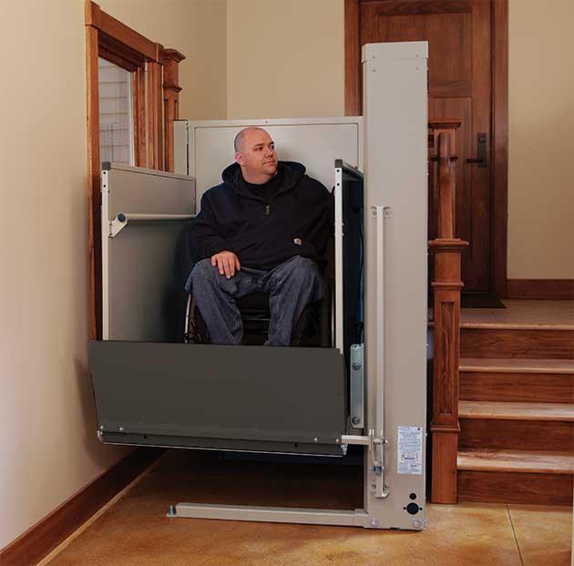 a vertical platform wheelchair lift in a home