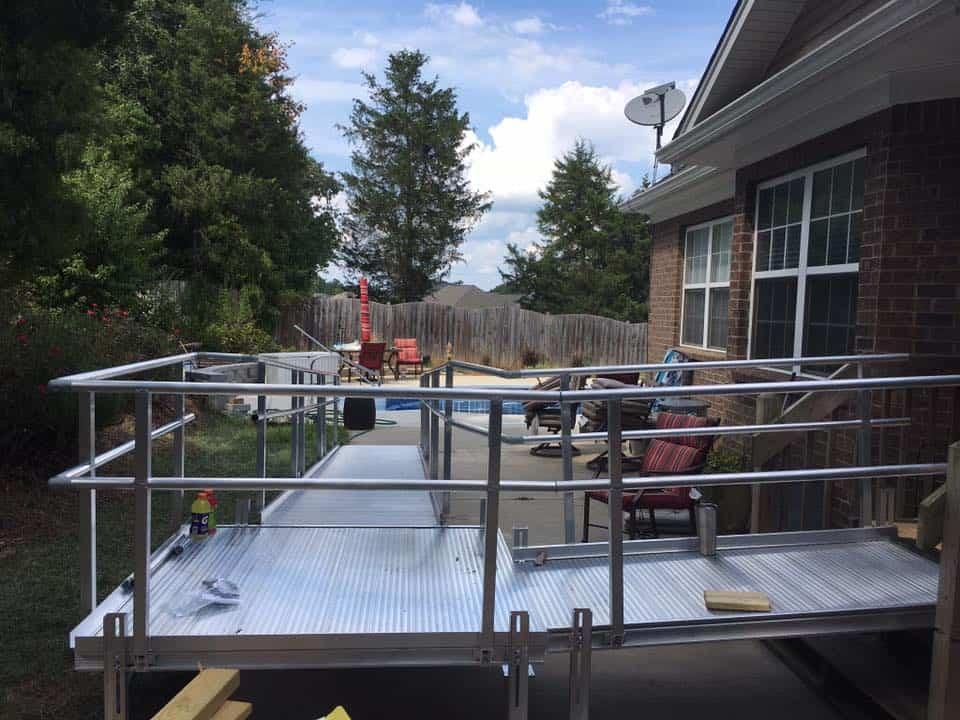 a wheelchair ramp in a backyard