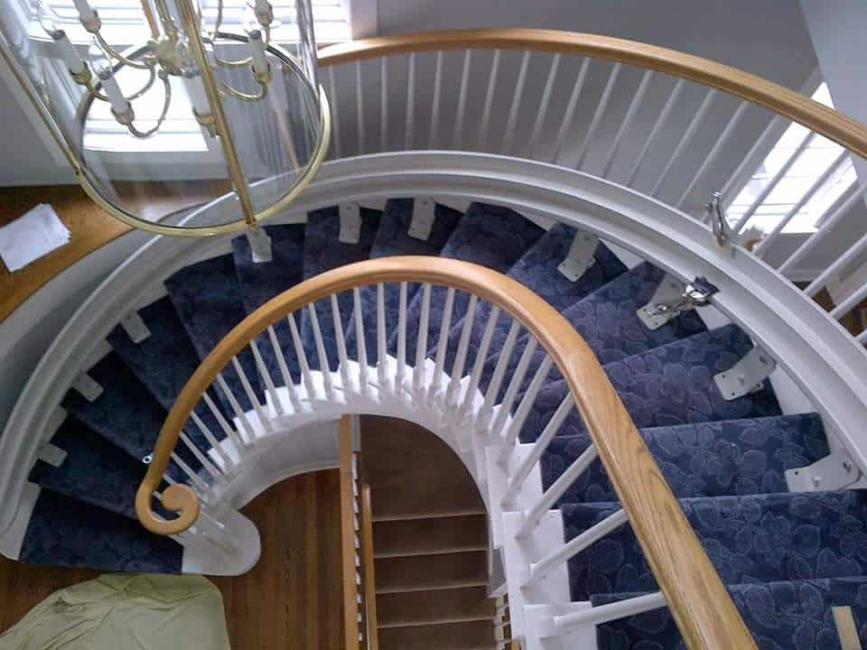 a curved staircase with a lift