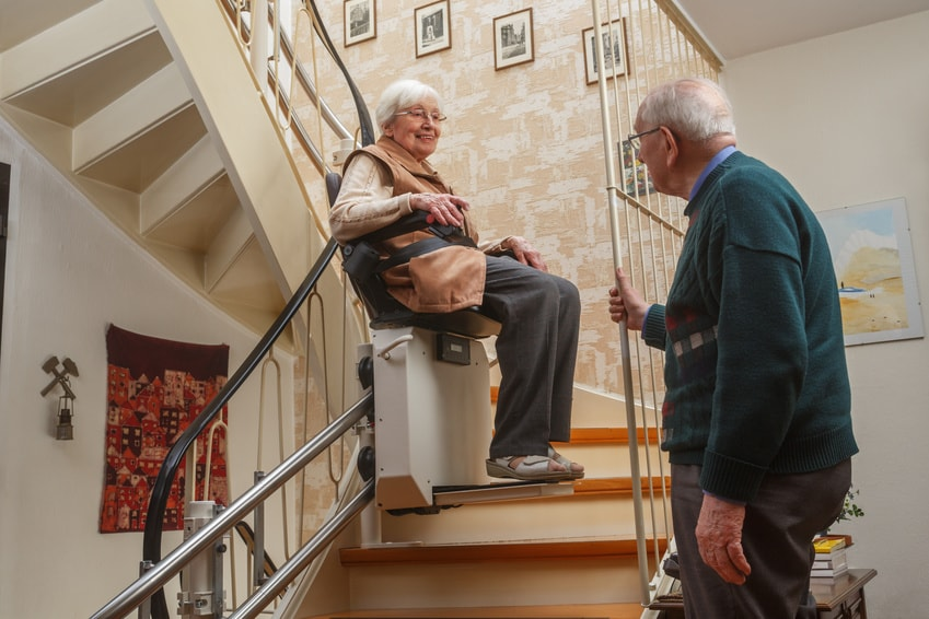 a woman using a stair lift