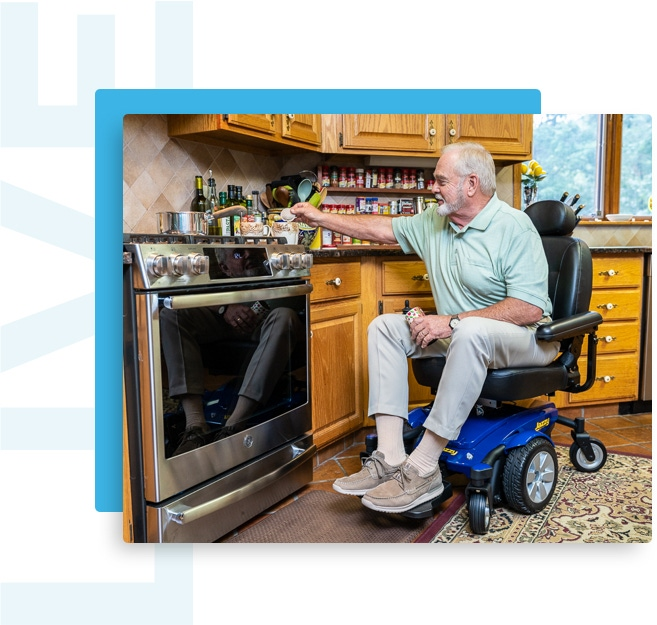 man in wheelchair cooking in the kitchen