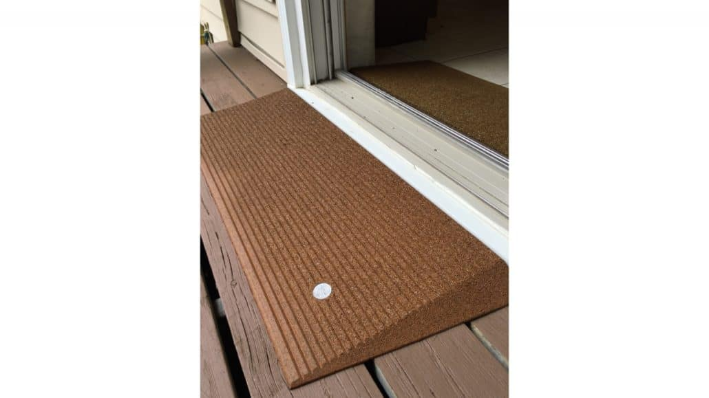 An angled mat entry in front of a door