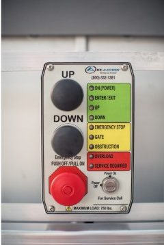 The control panel for the EZ-ACCESS PASSPORT® Vertical Platform Lift, which includes an up, a down, and an emergency button