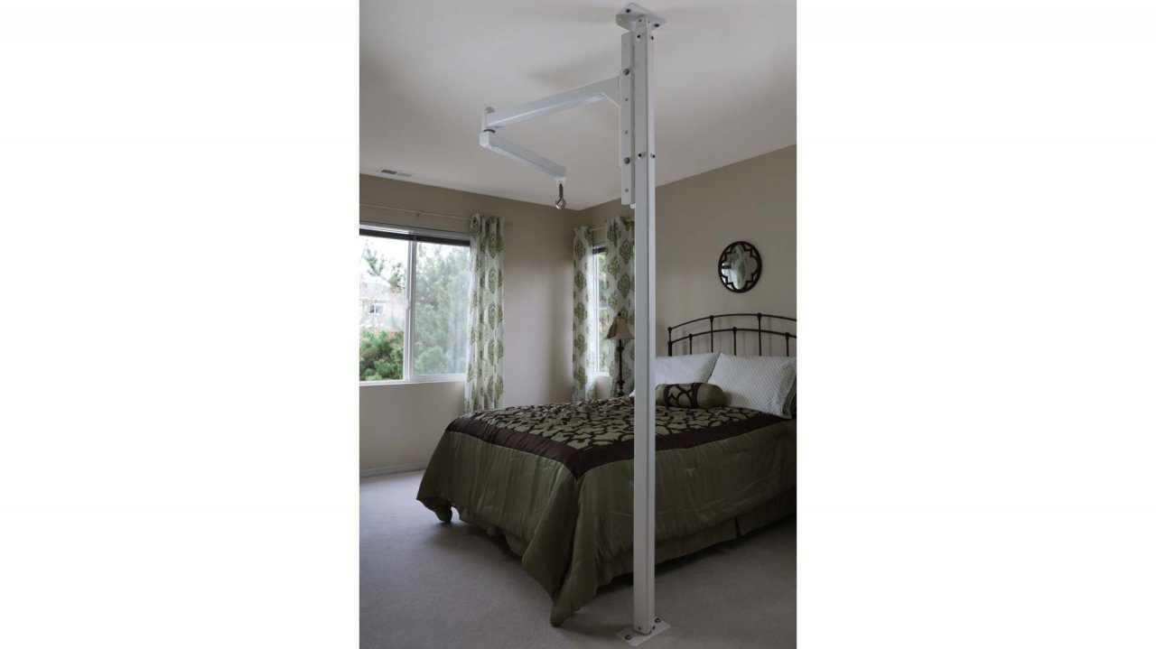 The orbit in a bedroom with grey bedding