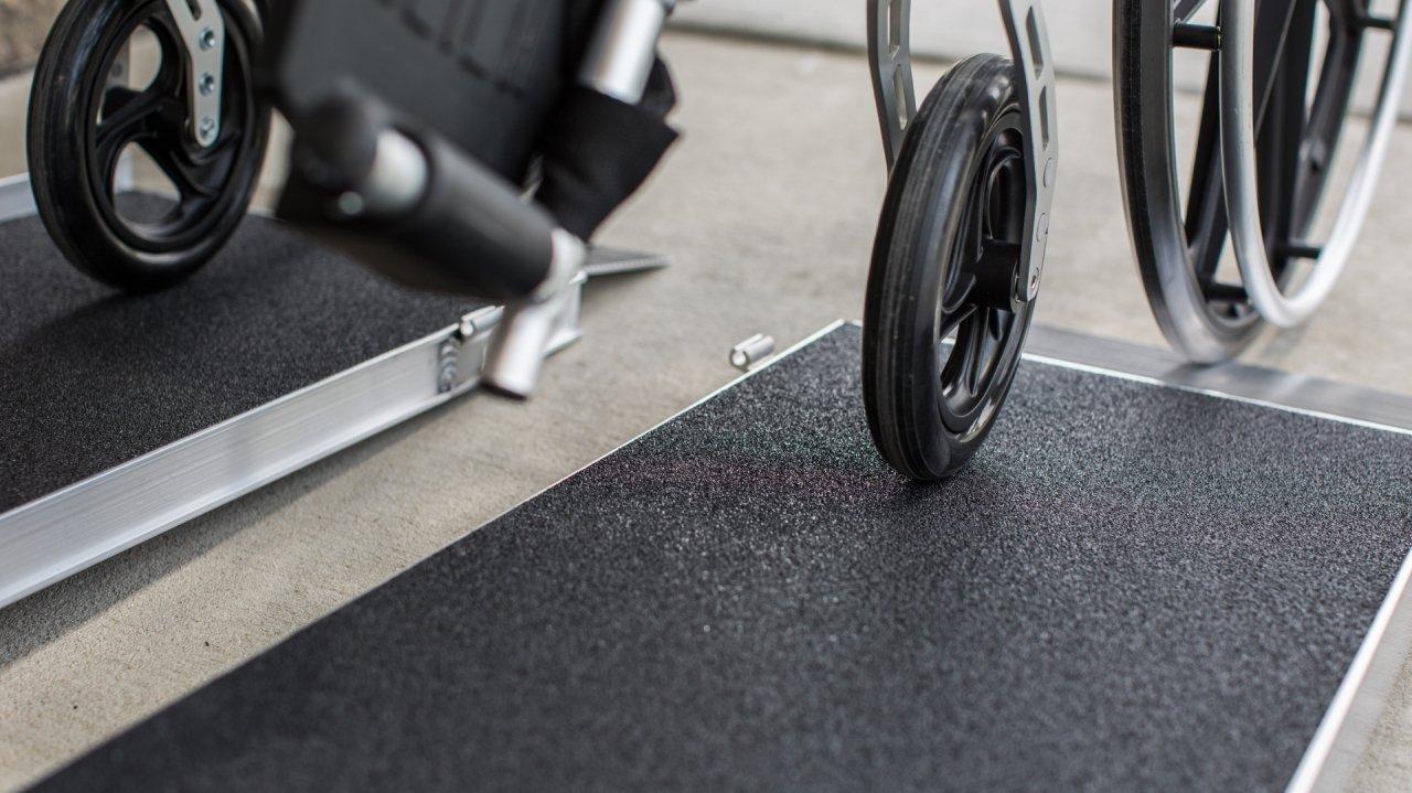 Singlefold Advantage Series Ramp with a wheel on it