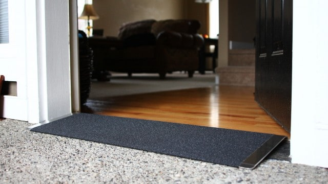 Black angled entry plate in front of a wood floor