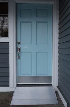 Angled entry ramp in front of a blue door
