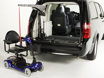 A scooter that's attached to a Big Lifter and a car