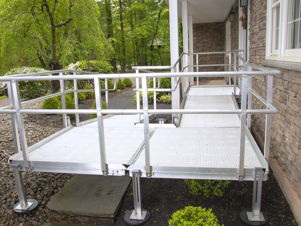 The side of an aluminum ramp in front of a house