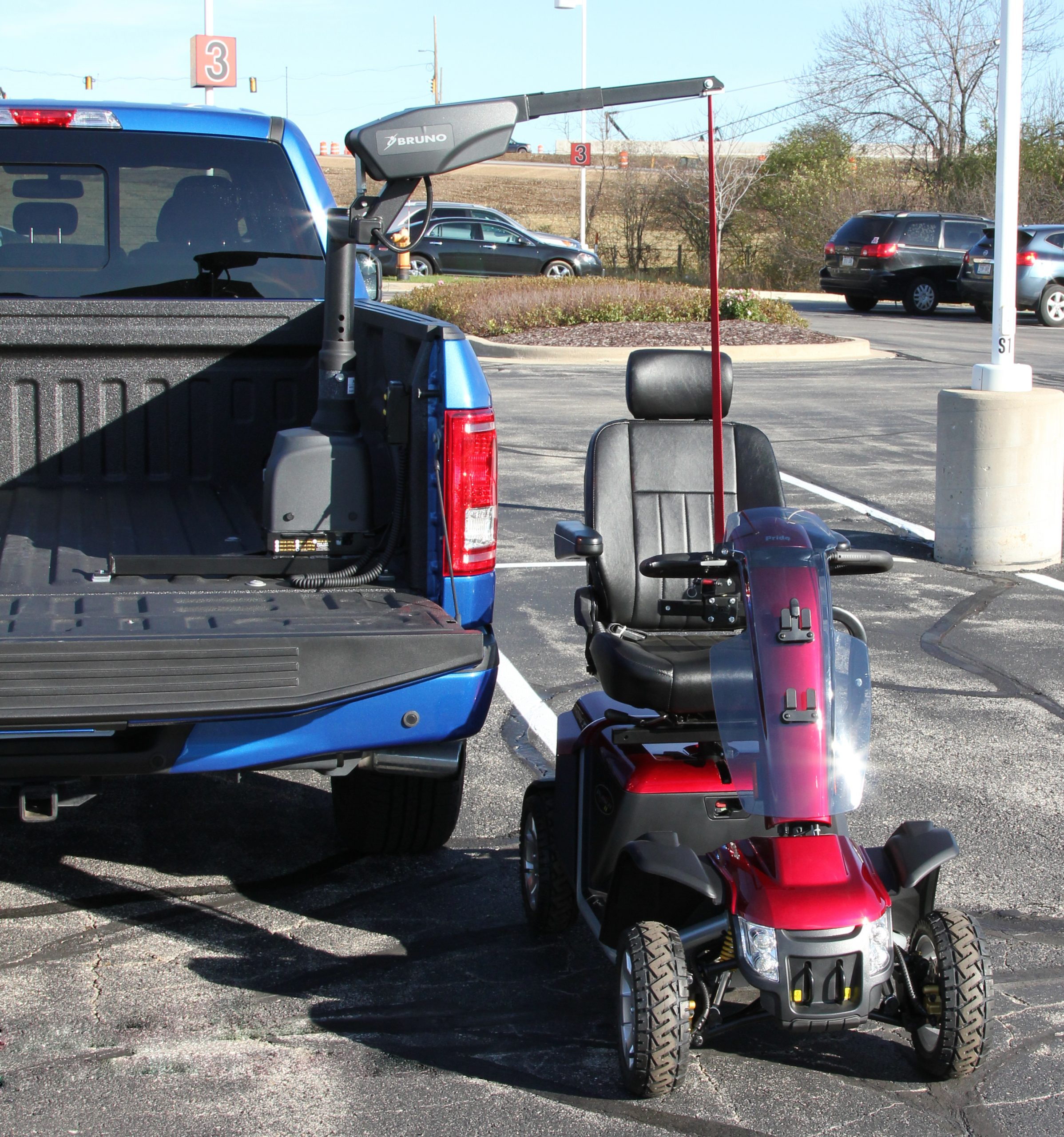 A scooter beside a truck using a curb sider