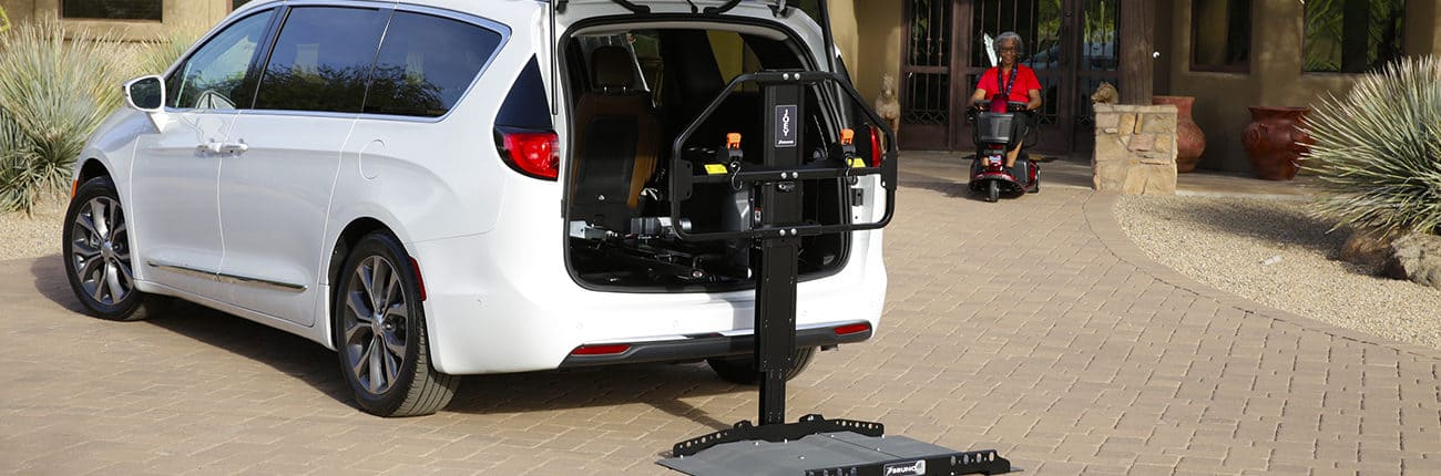 A vehicle lift leading into a car