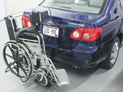 The Bruno Back Saver lifting a wheelchair into a car