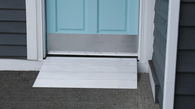 Modular entry ramp in front of a blue door