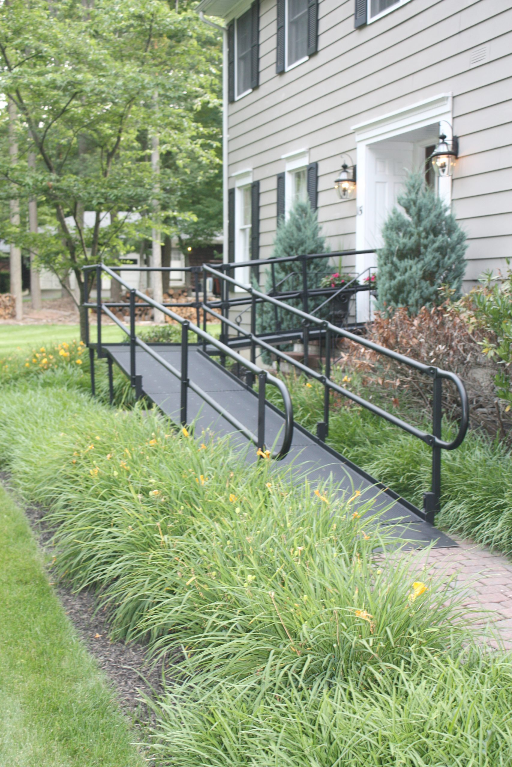 A black modular ramp in front of a building