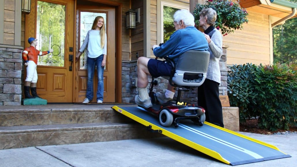Graphite Fiber Ramp with a man with a wheelchair on it