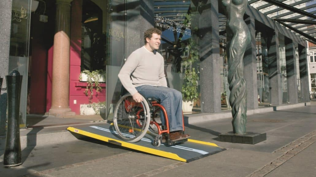Graphite Fiber Ramp with a man in a wheelchair on it