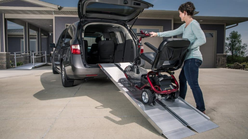 Singlefold ramp leading into a van with a wheelchair on it