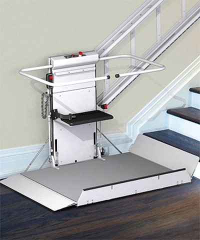 A platform lift leading up stairs