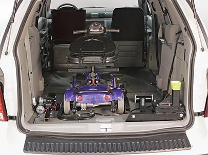 A scooter inside a van
