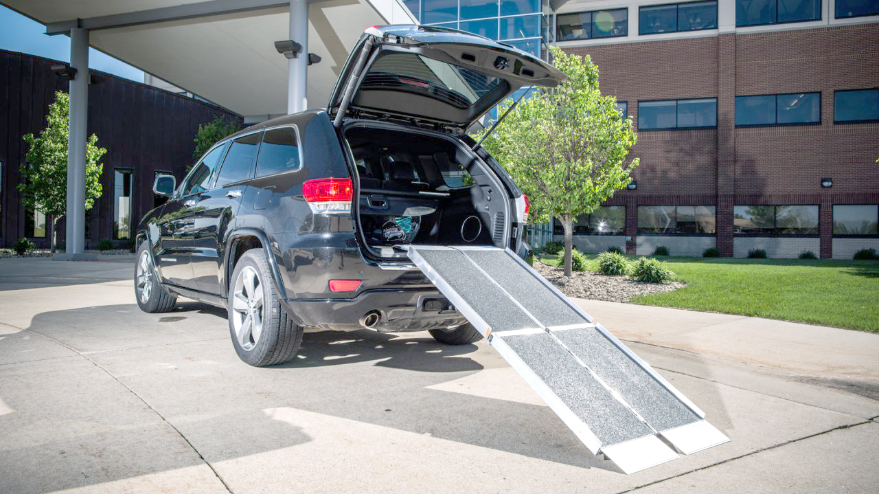 A Trifold Advantage Series Ramp leading into a car