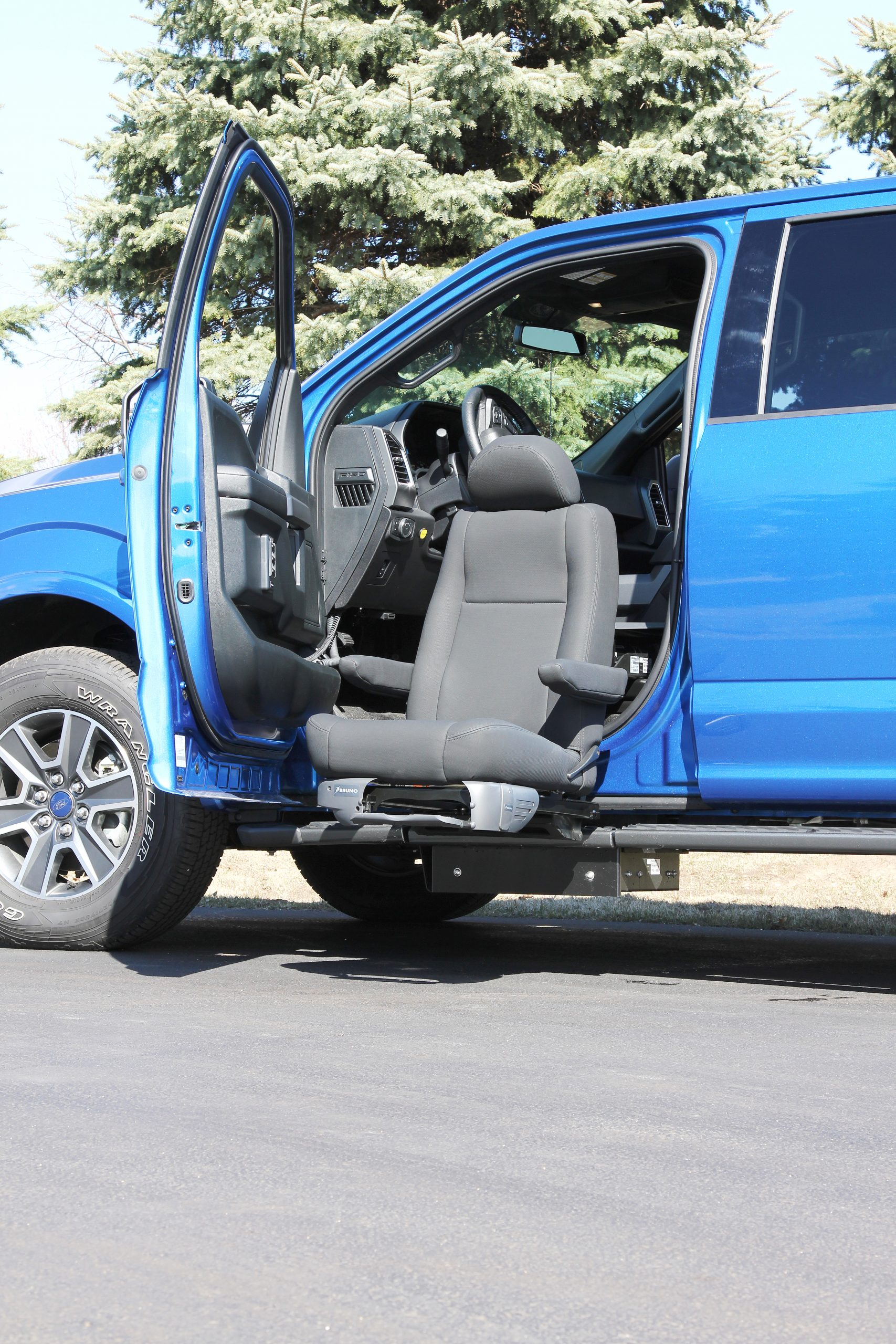 The Bruno Valet Seat in a blue truck
