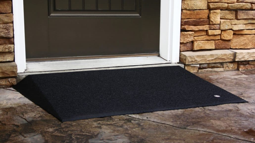 An angled entry mat in front of a door