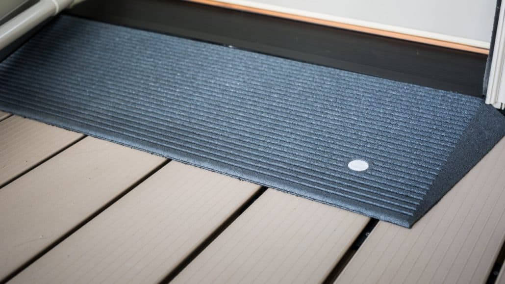 A blue angled entry mat in front of a door