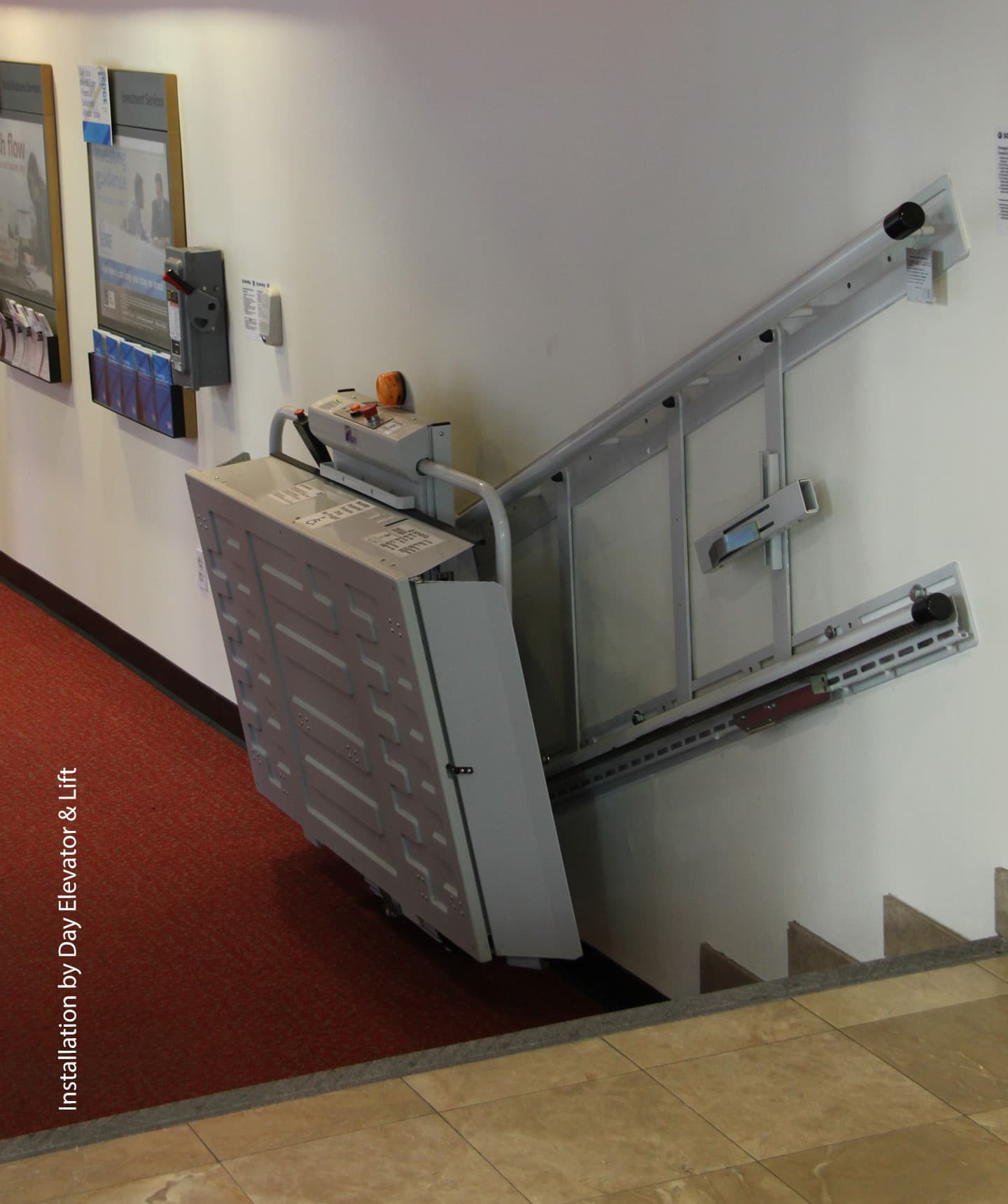 An incline platform that leads up the stairs inside a house