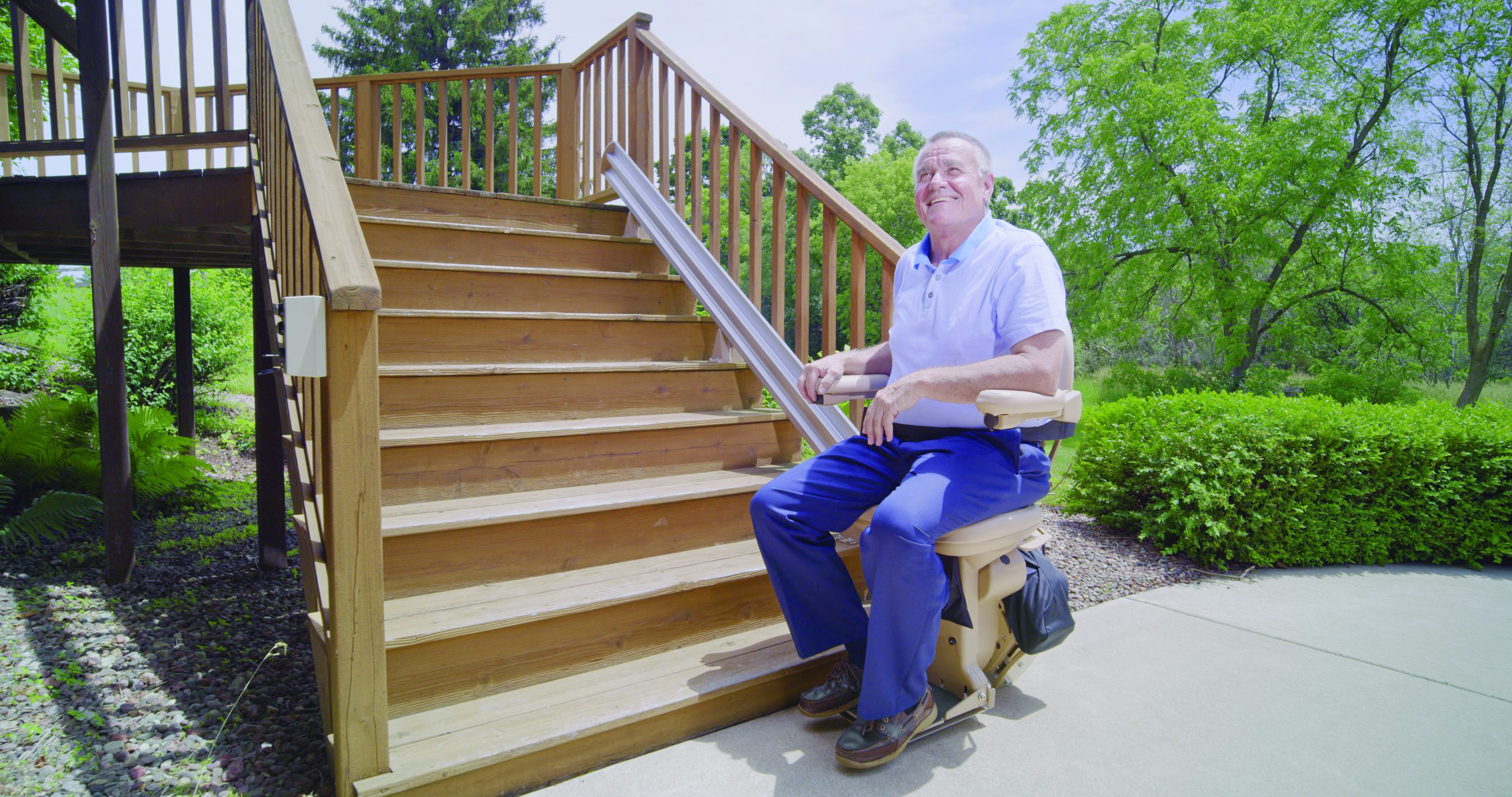 Man sitting on outdoor bruno stairlift