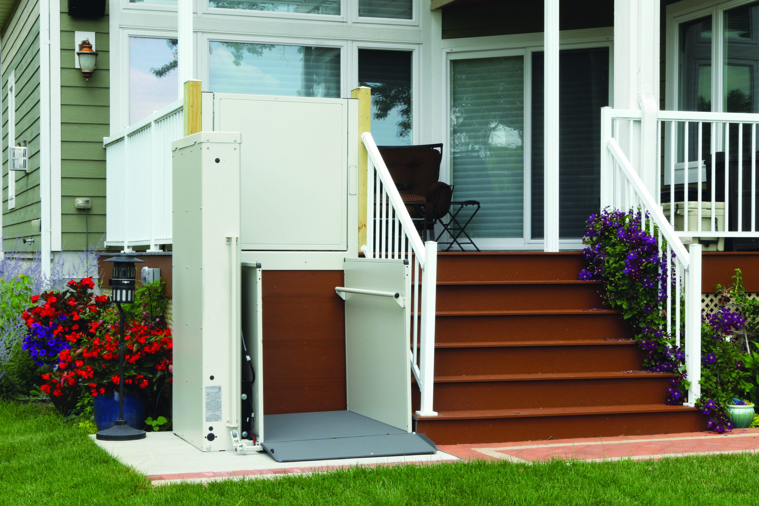 The Bruno Residential Vertical Platform Lift installed on stairs outside