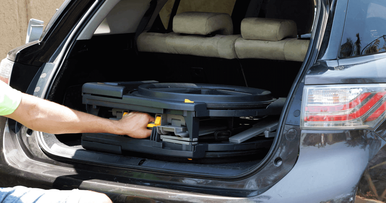 The Seatara WheelAble Toilet and Shower Chair being put into a car's trunk